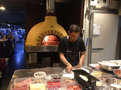 Mauto making pizza with the new pizza oven